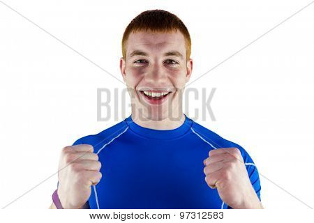 Portrait of an excited rugby player on a white background