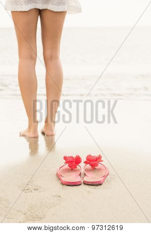 Woman paddling in the sea at the beach