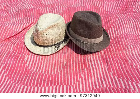 Two Hats On Pink Blanket