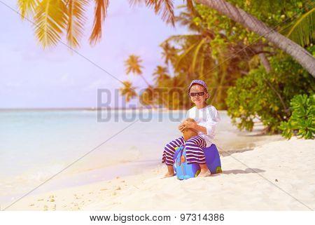 little boy travel on summer beach