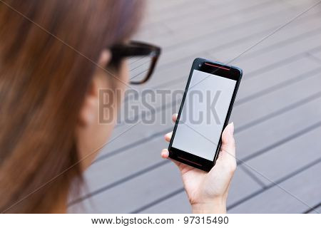 Woman hold a cellphone with blank screen