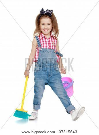Funny girl sweeping the floor