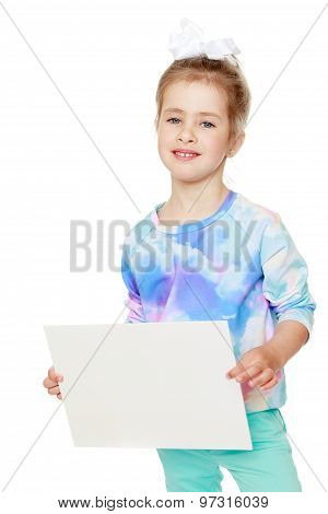 girl holds up a sheet of paper