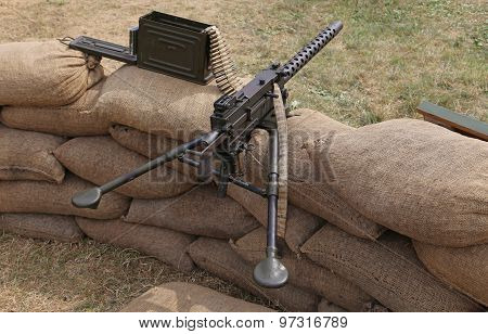 Machine Gun With Bullets In The Trench War