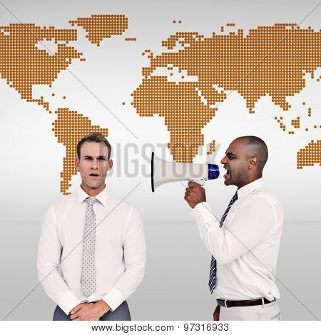 Businessman yelling with a megaphone at his colleague against orange world map on white background
