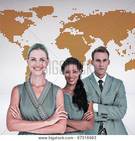 Happy business team smiling at camera against orange world map on white background