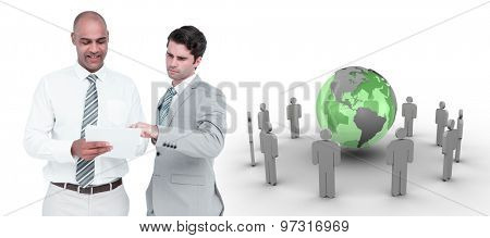 Businessmen working together against earth surrounded by men