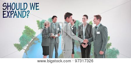 Business people shaking hands against grey background