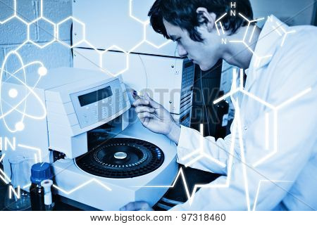 Science graphic against young chemistry student using a centrifuge