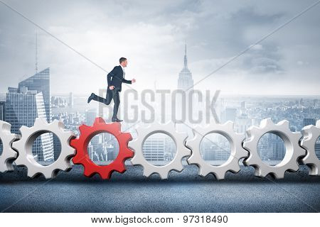 Businessman running against cityscape