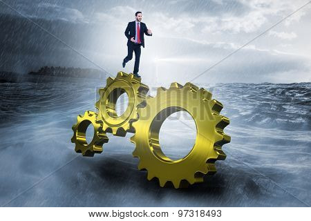 Smiling young businessman in suit running against stormy sea with lighthouse