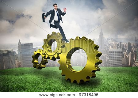 Stern businessman in a hurry against cloudy sky over city