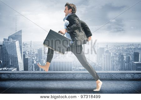 Leaping businessman against cityscape