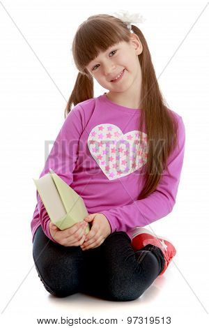 Girl with a book in his hands
