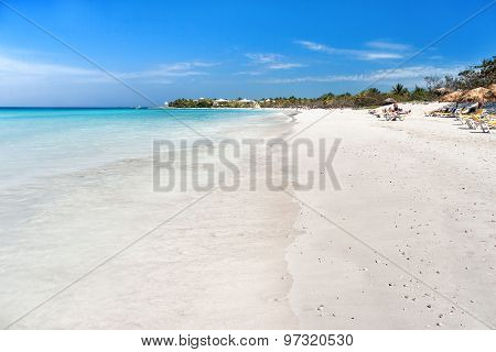 Soft Wave Of The Sea On The Sandy Beach. Blue Sky, White Sand, Palm Trees. Cuba, Varadero.