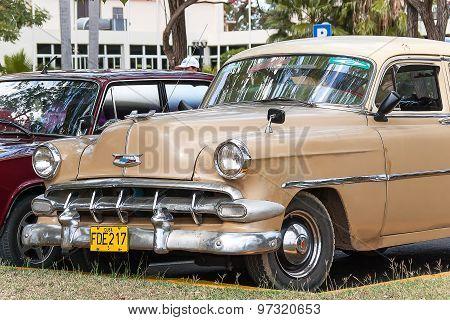 Havana, Cuba - February 5, 2008. Classic olrtimer car Parked Near Palm Trees.