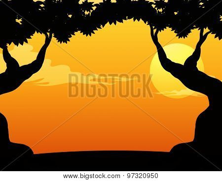 Silhouette trees with sunset background
