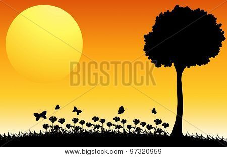 Silhouette field of flowers with butterflies