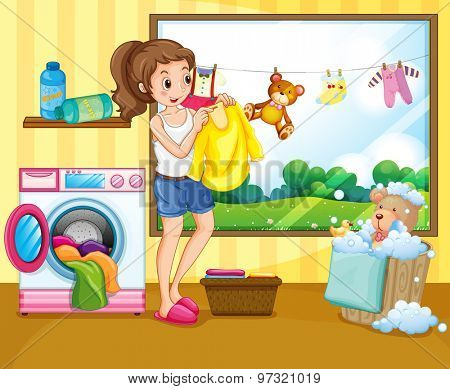 Girl washing and hanging clothes inside the house