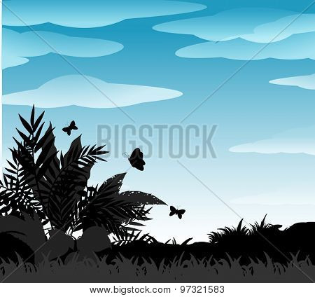 Silhouette bush and butterflies with blue sky background