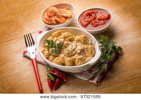gnocchi with shrimp sauce and tomatoes