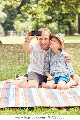 Father And Son Make A Self Photo On Picknik