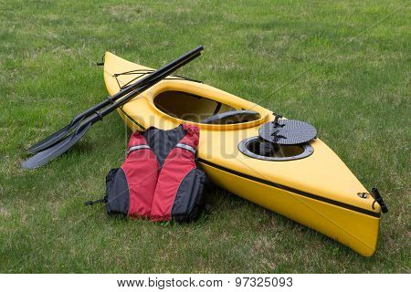 Kayak with Paddle and Life-vest.