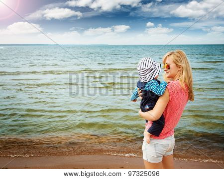 woman and baby at the beach near sea