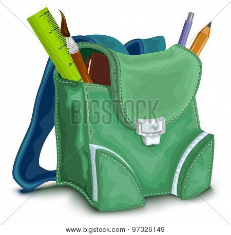 Green backpack with school supplies