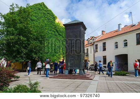Tourists Are Near Sculpture