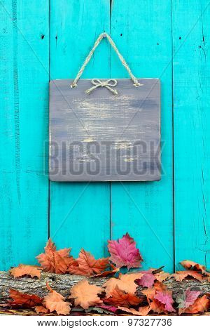 Rustic blank sign hanging on fence by fall decor border