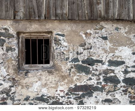 Facade of an old house with barred window