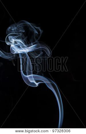 Colorful smoke abstract on black background