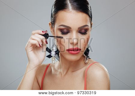 Attractive Young Woman Applying Mascara