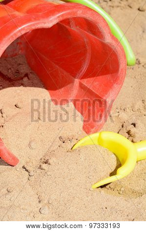 Children's Bucket And Shovel In The Sand