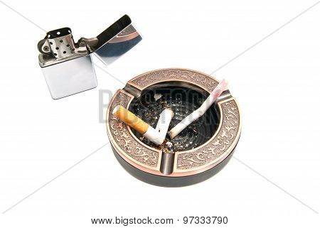 Butts In Ashtray And Metal Lighter