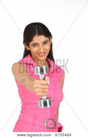 Teenage girl exercising with dumbbell