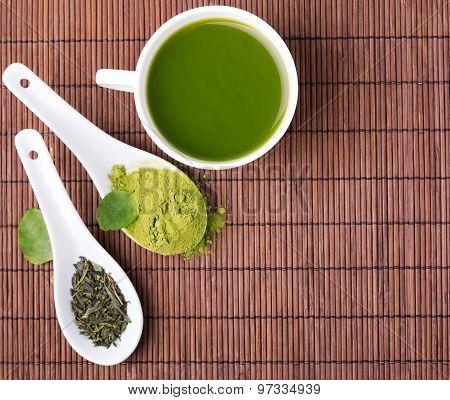 Green Tea On The Brown Mat