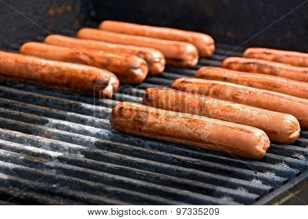 hot dogs on barbecue grill