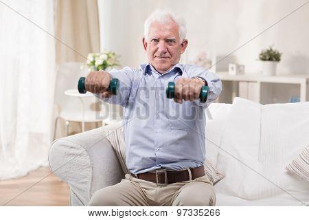 Senior Man Exercising With Dumbbells