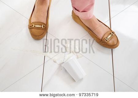 Female Leg With The Spilled Yoghurt