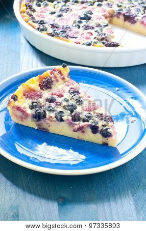 Clafoutis with cherries blueberries and berries