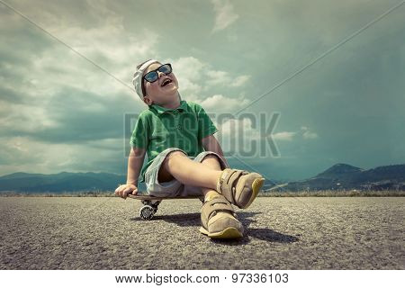 Child with skateboard under sunlight.