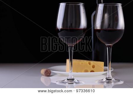 Glasses With Wine And Cheese