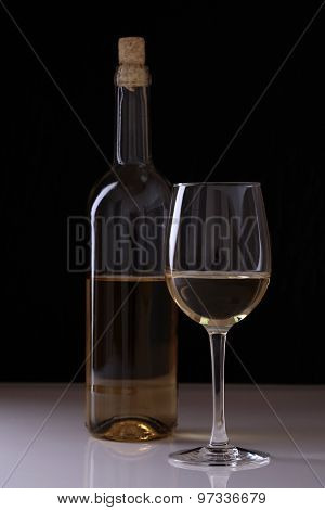 Bottle And Goblet With White Wine