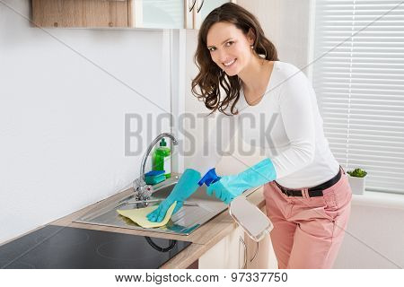Woman Cleaning Sink