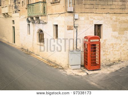 Red Telephone Cabin In The Medieval Old Town Of Victoria In Gozo - Mediterranean Malta Archipelago