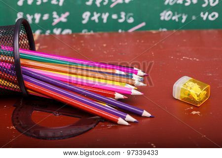 Colorful pencils of red yellow orange violet purple pink green and blue in stationary cup