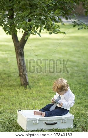 Curious Baby Boy With Vintage Briefcase