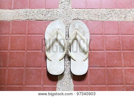 Close Up White Sandal On Floor